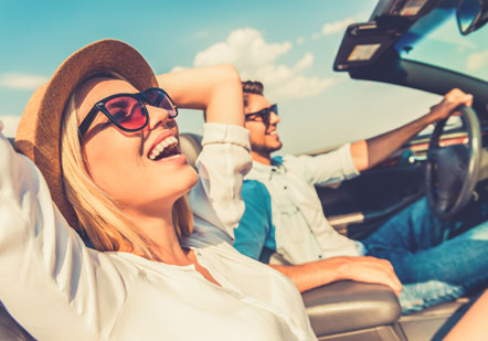 Smiling couple in convertible car